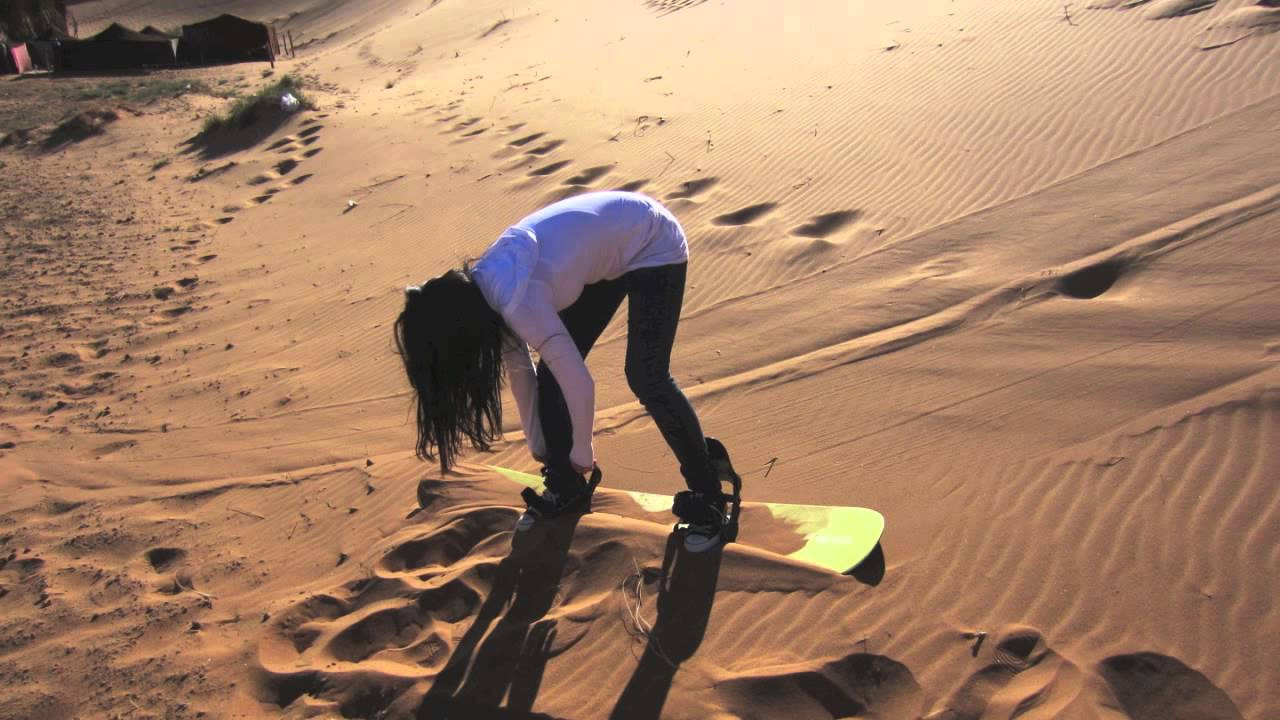 Sandboarding In The Desert Of Morocco